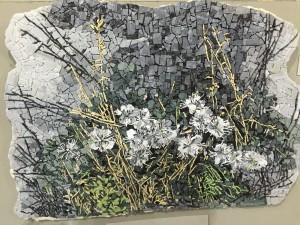 Denna mosaik är en kopia av en gammal målning. Den som gjort den studerar på en skola där man utbildar mosaikkonstnärer.